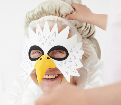 An old woman with an eagle mask.