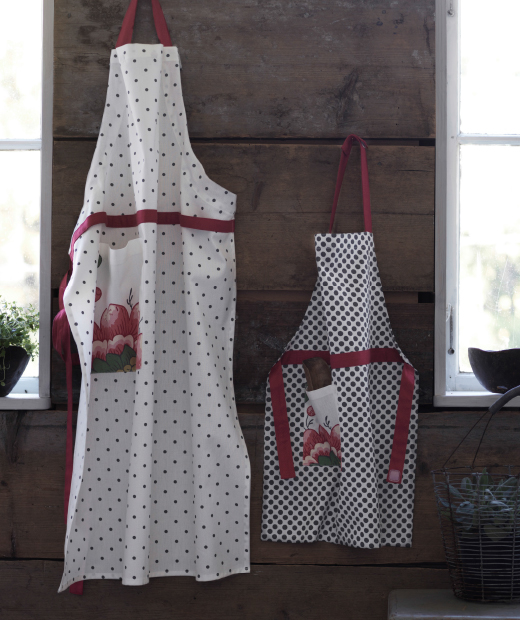 Two aprons with dots and flower pattern, one for adults and one for children.