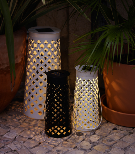 Cone-shaped table lamps with built-in LED light, shown outside.