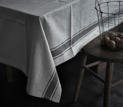A beige tablecloth with a darker border.