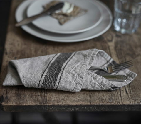 A knife and fork wrapped in a napkin made in a linen/cotton blend.