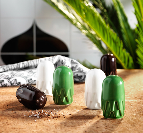 A display of salt and pepper shakers in brown, white and green earthenware.