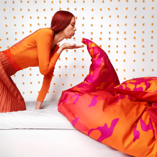 A duvet cover in orange and pink.