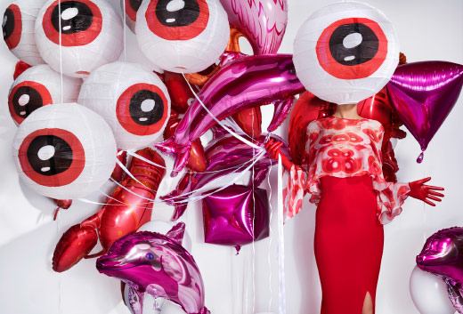 White rice paper shades with red eyeball pattern.