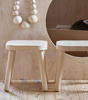 Two solid wood stools made for children.