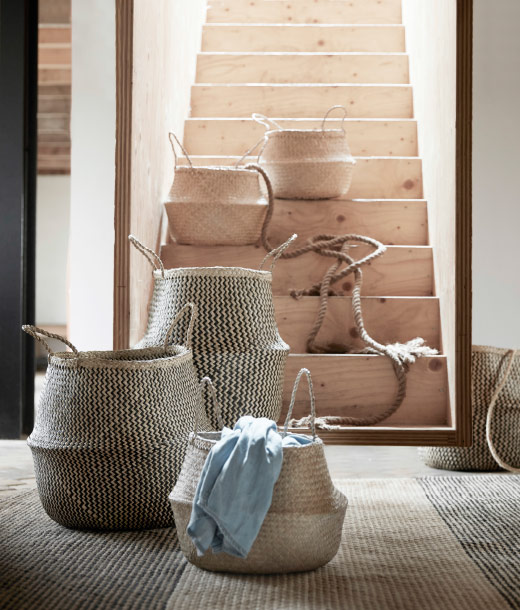 A display of seagrass baskets in different sizes.