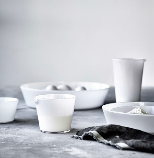 White glass jugs shown together with bowls in different sizes.