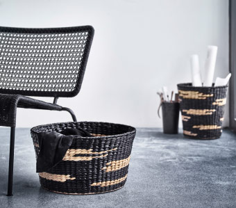 Two handmade water hyacinth baskets in black with natural-coloured pattern.
