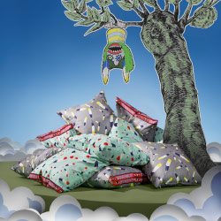 A pile of cushions with cushion covers in fun and colourful patterns.