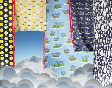 A display of pre-cut fabrics with fun and playful patterns.
