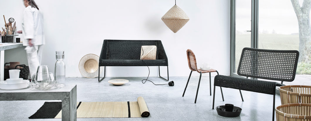 Display of a collection in bamboo and rattan. Consisting of sofas, easy chairs, rugs, baskets and pendant lamps.