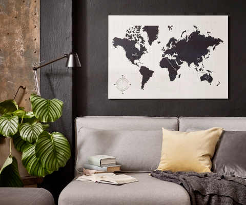 A white blackboard with a world map where you can plan your trips.