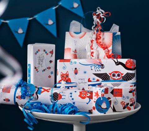 A table filled with gifts wrapped in playful paper.