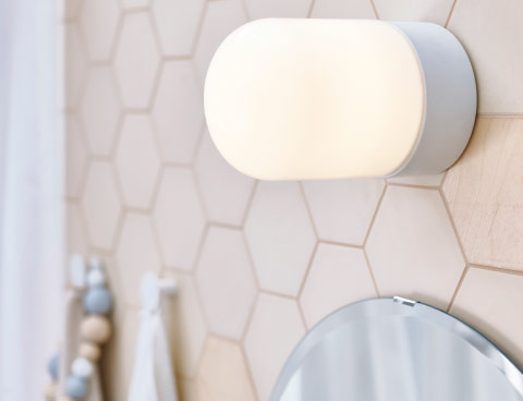 A white tube-shaped bathroom lamp, that can be used both in the ceiling and on the wall.