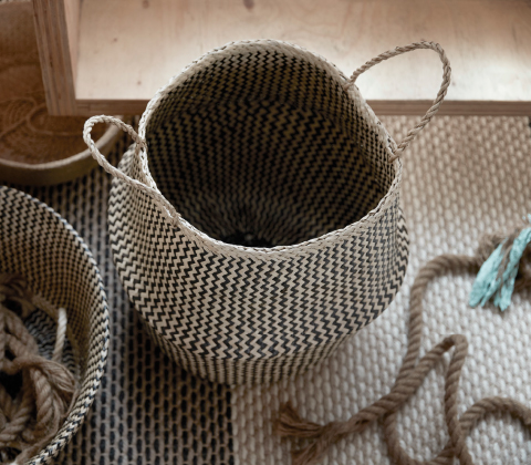 A seagrass basket where you can fold the upper half to make it smaller.