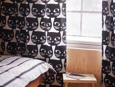 Curtains with black cat face pattern.