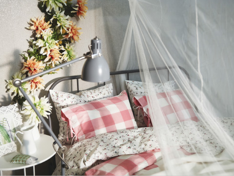 A bed with floral and checkered bedlinen covered by a white mosquito net