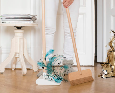 A broom and dustpan with solid beech handles.