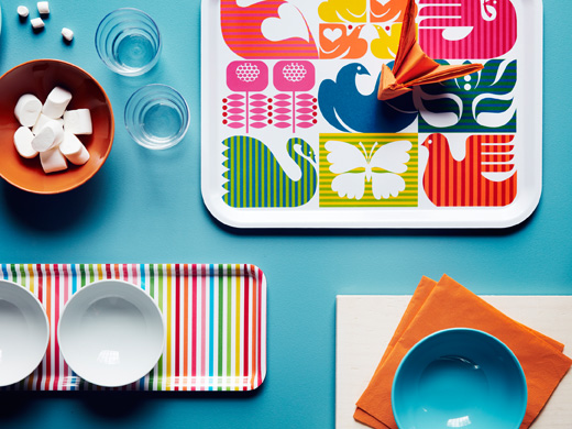 Two colourful trays, one striped and one with bird pattern, seen from above.
