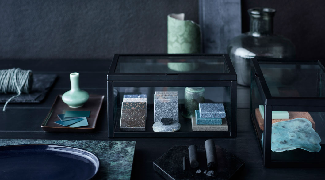 A glass box with black edges perfect for storing small items.