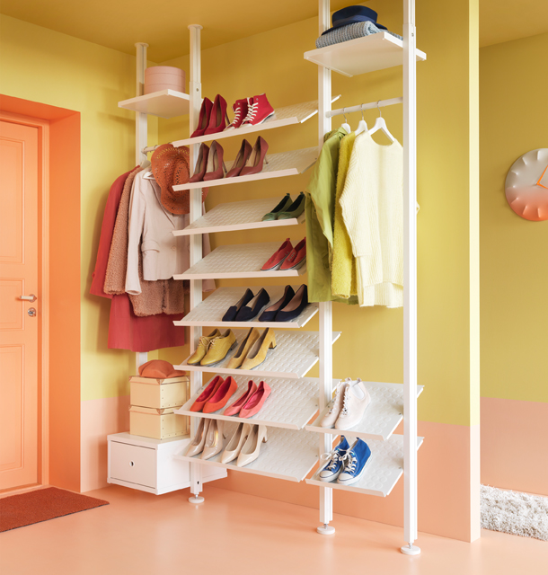 A white storage combination with shoe shelves, shelves and a drawer.