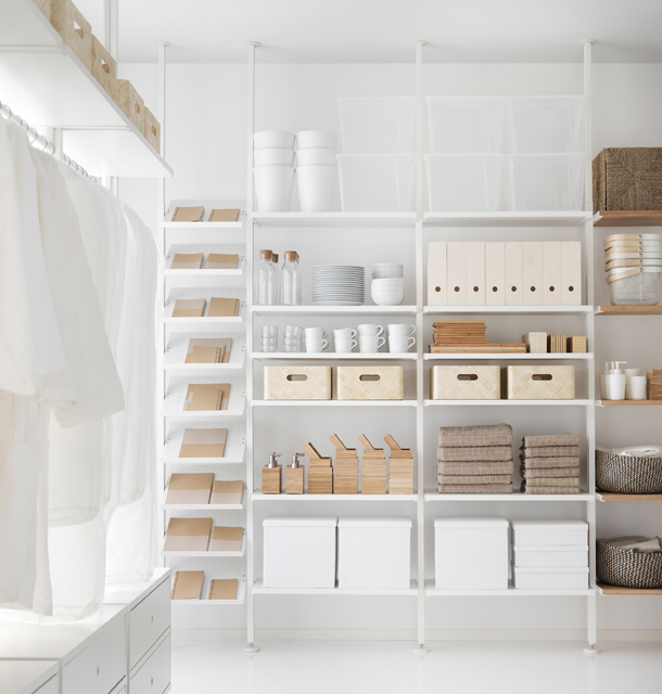 A white storage combination with shoe shelves, shelves and bamboo shelves.