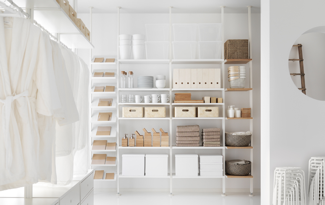 A white storage combination with shoe shelves, shelves and bambo shelves.