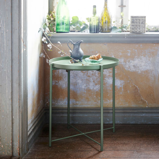 A dark green tray table with removable tray.