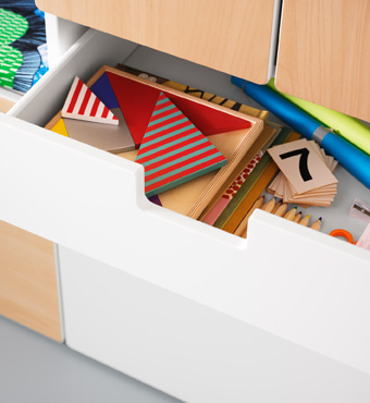 A close up of an open drawer.