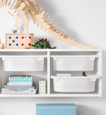 A white wall shelf with white storage boxes in plastic.