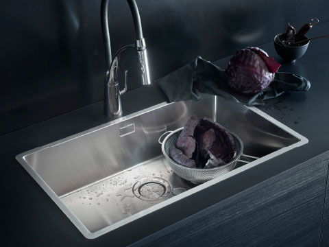 A rectangular stainless steel sink and a kitchen mixer tap with handspray.