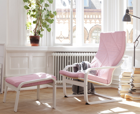 An armchair and footstool with layer-glued bent birch frame, stained white, and pink cushions.