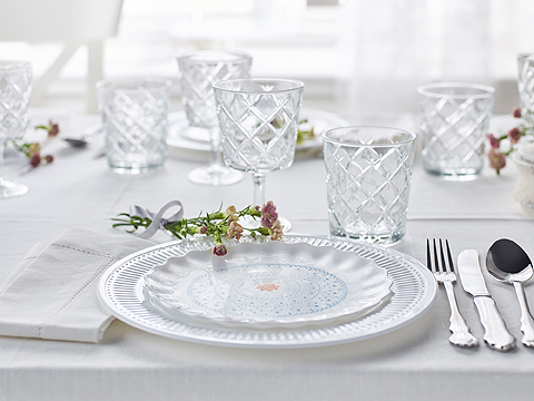 A set table with side plate, plate in white tempered glass, wine glass, tumbler and stainless steel cutlery.
