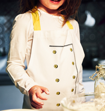 Close-up of a girl wearing an apron.