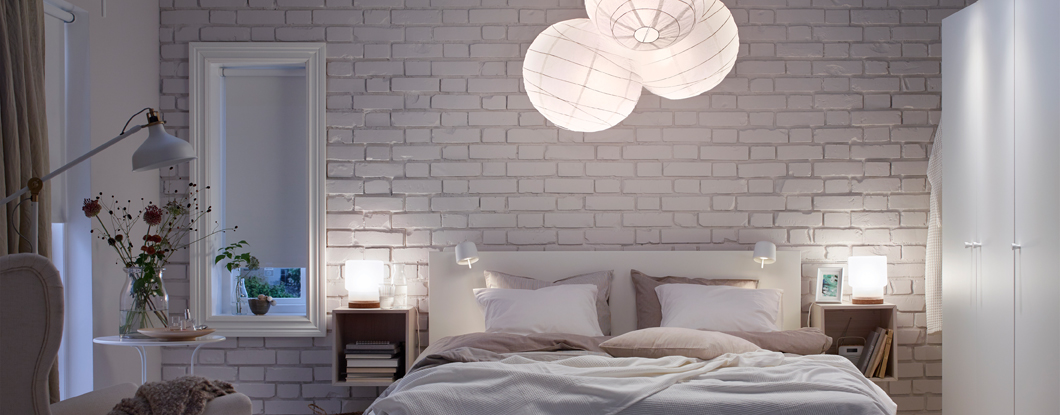 Comfortably lit cosy white bedroom.