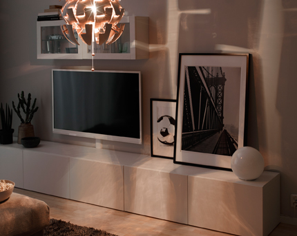 Part of a livingroom with a TV and an ambient glow of general light.