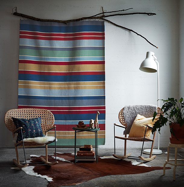 A colourful striped wool rug hung on the wall as a decoration.