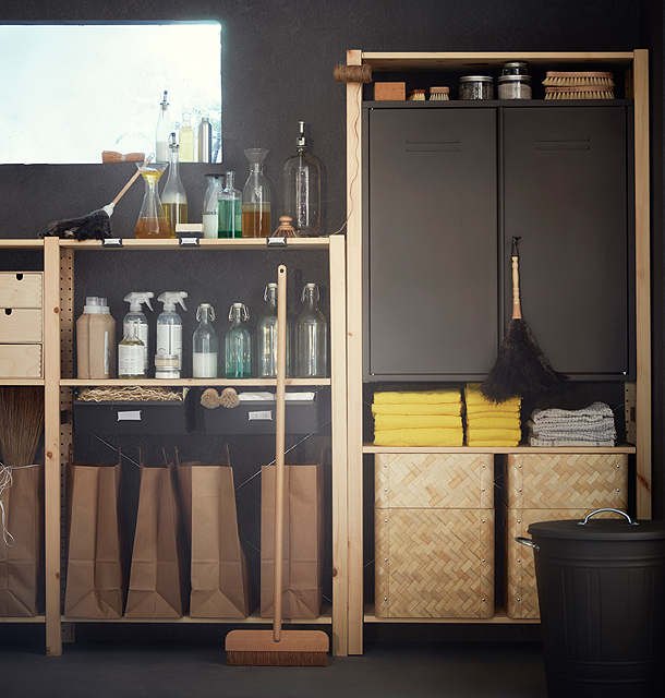A gray steel cabinet shown in a shelving unit made of untreated solid pine. The shelving unit is also filled with brown paper bags, bamboo baskets and glass bottles.