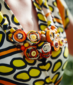Close-up of a necklace made of colourful fabric, buttons and wooden beads.