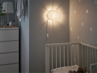 A soft wall lamp over the baby crib gives your child a feeling of safe in the dark.