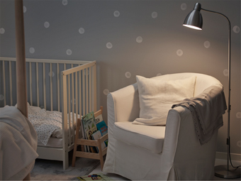 Adjustable floorlamp and a comfy armchair next to the baby crib, for convinience when reading bedtime stories.