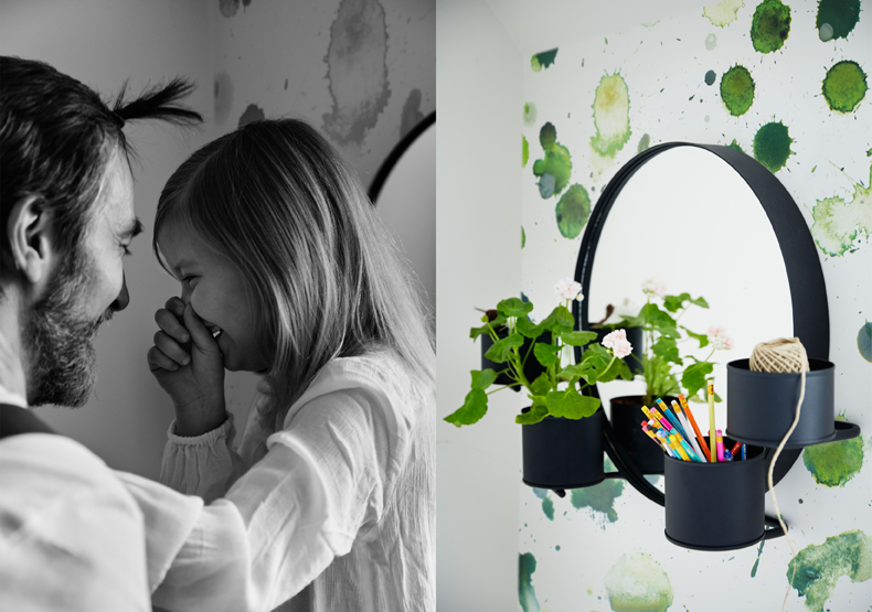 A round black mirror with four cups for plants, pencils or brushes.