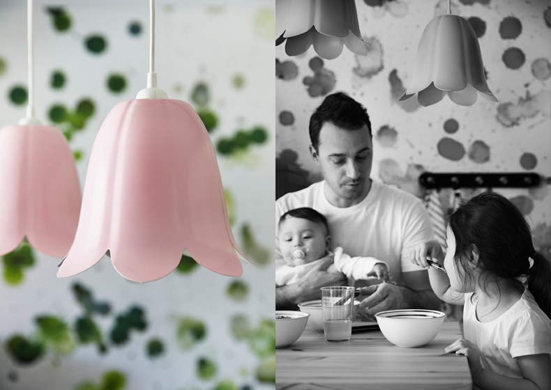 A pink lamp shade in the shape of a bell.