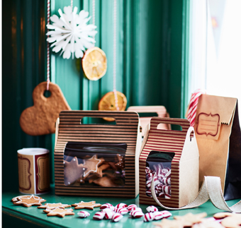Gift boxes in brown paper with plastic windows, filled with homemade cookies and peppermint rock candy.