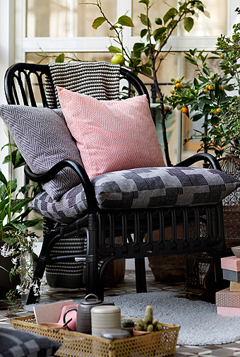 Handwoven cushion covers in light pink and grey with herringbone pattern and check pattern.