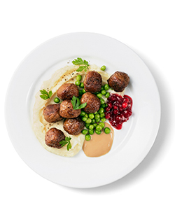Classic Swedish Meatballs – served with mashed potatoes, green peas, gravy and lingon berry jam.