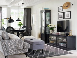 Traditional living room in black and white with a TV bench with sliding glass doors.