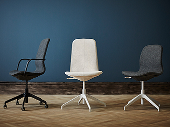 Three office desk chairs- one in gray with black arms and base, one beige with white base, and one gray with white base.