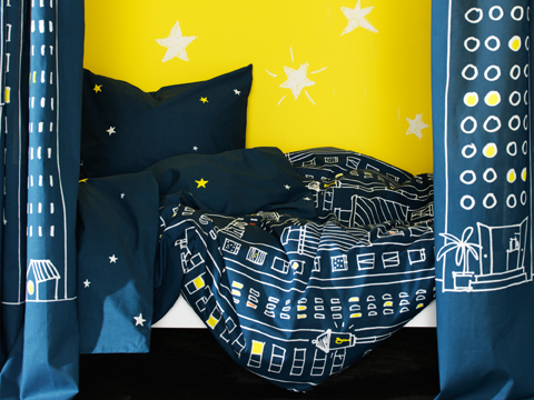 Blue quilt cover and curtains in 100% cotton with stars and cityscapes.