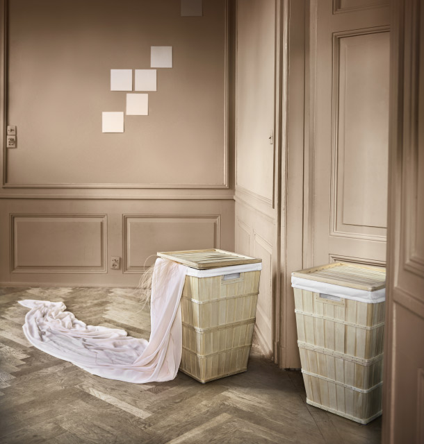 Two laundry baskets made of solid wood, each has a lid and an inner bag that is removable and washable.